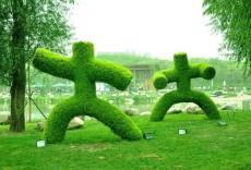 仿真绿雕价格制作稻草人工艺品城市绿雕厂家