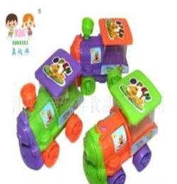 (廠家直銷)供應3039真伙伴奶瓶裝回力卡通火車新玩具糖果